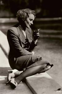 Marlene Dietrich Sitting at Pool and Smoking